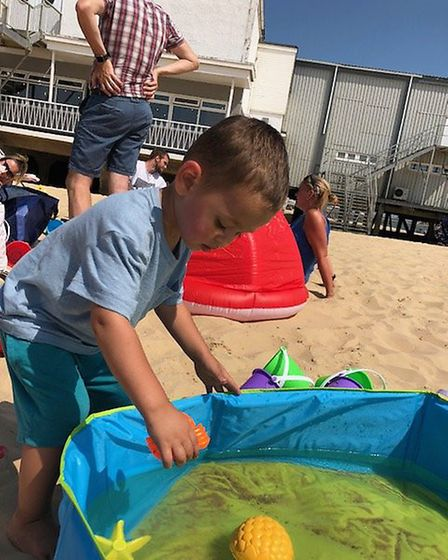 Ryan Hammed splashes around at the ECCH Family Nurse Partnership beach partyPictures: East Coast Com