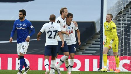 Giovani Lo Celso of Tottenham Hotspur is congratulated after his shot led to the first goal during T