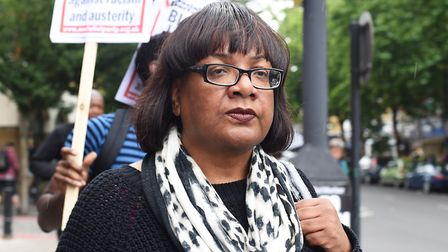 Diane Abbott arrives at a protest at Stoke Newington police station over the death of Rashan Charles
