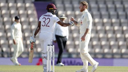 West Indies John Campbell (left) and England's Ben Stokes bump fists after day five of the first Tes