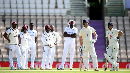 West Indies players review a delivery to England captain Ben Stokes (right) which results in a not o