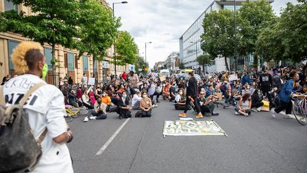 Sisters Uncut and other activists proceeded to blockading a nearby road to protest an increased poli