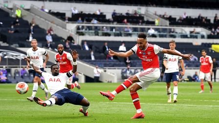 Arsenal's Pierre-Emerick Aubameyang (right) sees his shot hit the crossbar