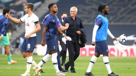 Tottenham manager Jose Mourinho (centre) on the pitch after the Premier League match at Tottenham Ho
