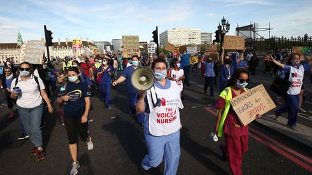 NHS workers marching to Downing Street to demand a pay rise. Picture: Yui Mok/PA