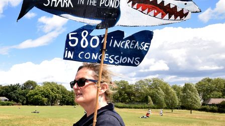 Protesters walk over Hampstead Heath towards the ponds on as part of the Save Our Ponds campaign on