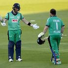 Ireland's Paul Stirling (right) celebrates reaching his century with captain Andrew Balbirnie, who a