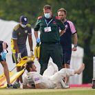 Hampshire's Liam Dawson lies in pain after picking up an injury during day two of The Bob Willis Tro