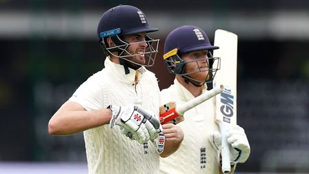 England's Dom Sibley (left) and Ben Stokes walk off on day one of the Second Test at Emirates Old Tr