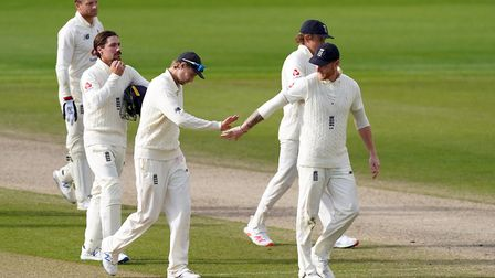 England's Joe Root (left) and Ben Stokes (right) celebrate after their win in the Second Test at Emi