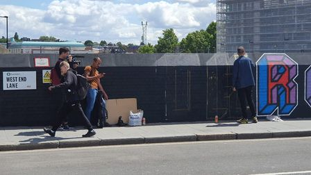 Mr Eine repairing the defaced mural on July 11. Picture: Archant