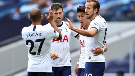 Tottenham Hotspur's Harry Kane (right) celebrates scoring his sides third goal of the game with team