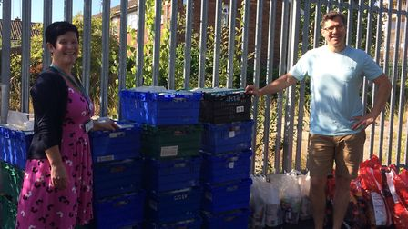 Coppetts Wood headteacher Kirstie Barrett (left) takes delivery of food parcels from Muswell Hill Fo
