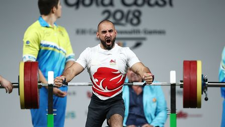 Ali Jawad of England celebrates a lift in the men's lightweight final during the Para Powerlifting o
