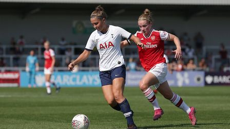 Tottenham's Hannah Godfrey holds off Arsenal rival Kim Little during the 2019-20 season (pic Gavin E