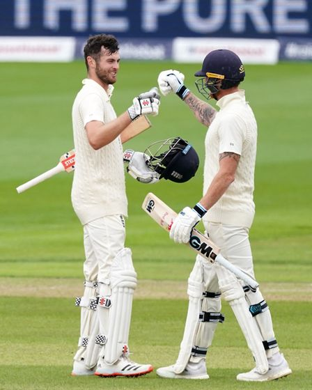 England's Dom Sibley (left) celebrates with Ben Stokes after making his century
