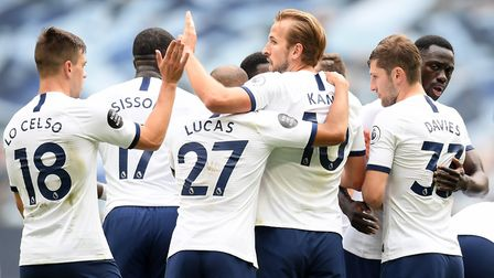Tottenham Hotspur's Harry Kane (centre) celebrates scoring his side's third goal of the game with te