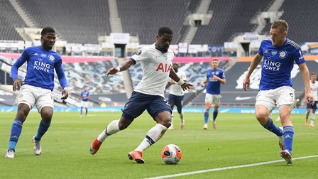 Tottenham Hotspur's Serge Aurier (centre) in action with Leicester City's Kelechi Iheanacho (left) a