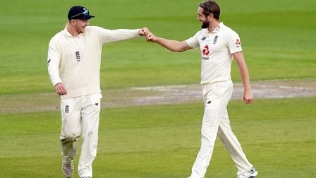 England's Chris Woakes celebrates after taking the wicket of West Indies Shannon Gabriel