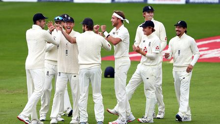 England's Stuart Broad (centre) celebrates taking the wicket of West Indies' John Campbell with team