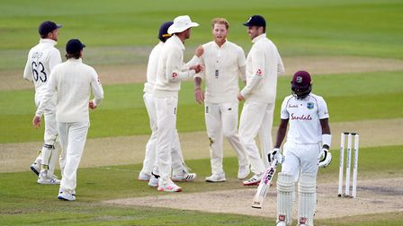 West Indies' Jermaine Blackwood walks off the pitch after losing his wicket to England's Ben Stokes