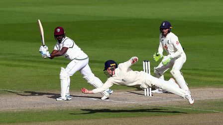 England's Ollie Pope takes the winning catch to dismiss West Indies' Kemar Roach