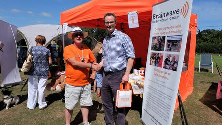 Brainwave Independence Group chairman David Revell with Waveney MP Peter Aldous at the charity's ann