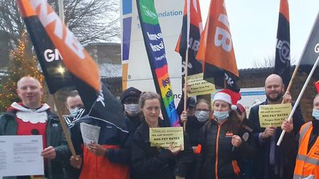 Domestics from Homerton Hospital protest outside in December over their pay and conditions, joined b