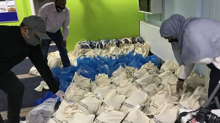 Volunteers pack food parcels at the Central London Youth Development Trust. Picture; CLYD