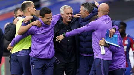 Tottenham Hotspur manager Jose Mourinho (centre) reacts after the final whistle
