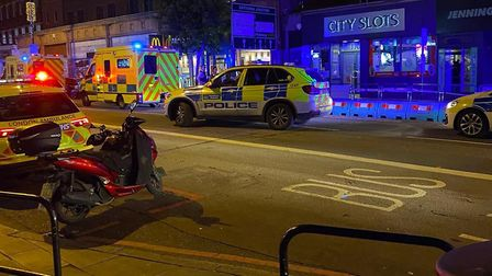 Police cars and paramedics in Camden High Street on Tuesday night. Picture: Joshua Lyons