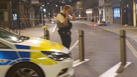 Police tape off the crime scene after someone was stabbed in Broadway Market. Picture: @999London