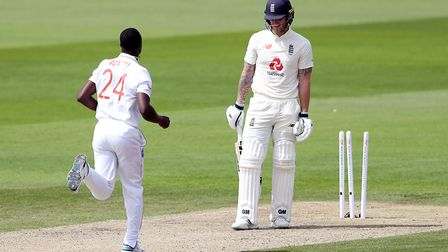 England's Ben Stokes reacts after being clean bowled by West Indies' Kemar Roach