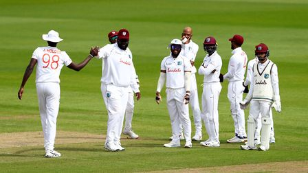 West Indies' Rahkeem Cornwall (second left) celebrates catching England's Rory Burns in the slips