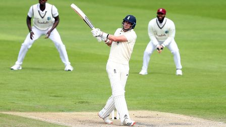 England's Stuart Broad hits a six as he bats during day two of the Third Test at Emirates Old Traffo