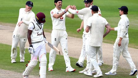 England's James Anderson (third left) celebrates with team-mates after taking the wicket of West Ind