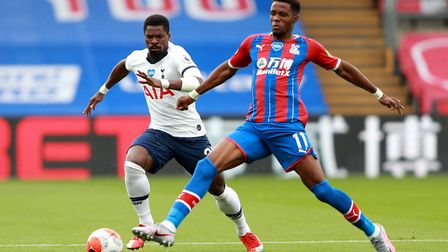 Tottenham Hotspur's Serge Aurier (left) and Crystal Palace's Wilfried Zaha battle for the ball