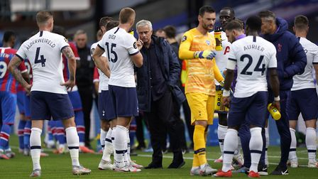 Tottenham Hotspur manager Jose Mourinho instructs players during the drinks break