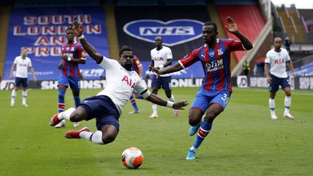 Tottenham Hotspur's Serge Aurier (left) and Crystal Palace's Tyrick Mitchell battle for the ball