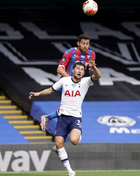 Crystal Palace's Joel Ward and Tottenham Hotspur's Ben Davies compete for a header