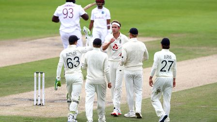 England's Stuart Broad (centre) celebrates with team-mates after taking the wicket of West Indies' R