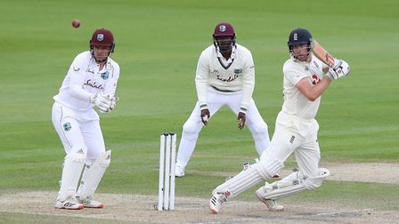 England's Dom Sibley hits out as West Indies wicketkeeper Joshua Da Silva looks on