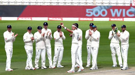 England's Stuart Broad (centre) celebrates taking his 500th Test wicket with teammates during day fi