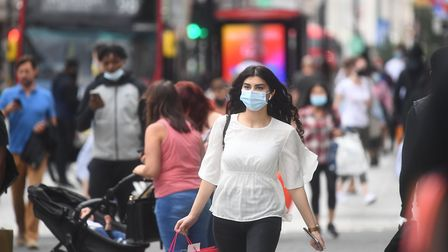 People wearing face masks on Oxford Street, London, as face coverings become mandatory in shops and