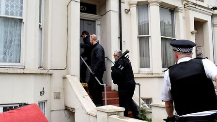 Police use a rapid entry team to gain access to a property on Isledon Road N7 during a Section 23 dr