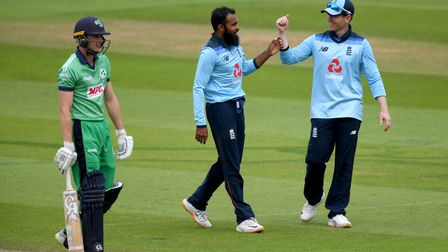 England's Adil Rashid (centre) celebrates with captain Eoin Morgan after taking the wicket of Irelan
