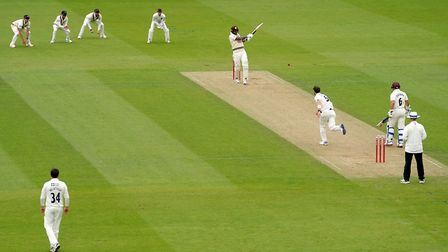 Surrey's Jordan Clark hits out off the bowling of Middlesex's James Harris during the friendly match