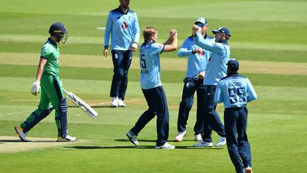 England's David Willey (third left) celebrates after taking the wicket of Ireland captain Andrew Bal