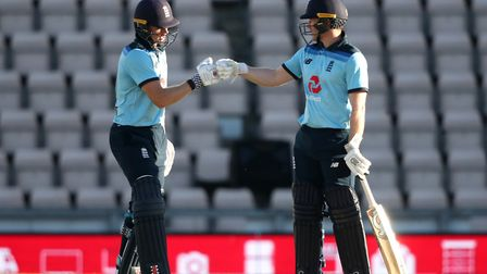 England captain Eoin Morgan (right) fist bumps Sam Billings during the first One Day International o