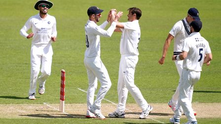 Middlesex's Tim Murtagh (third right) celebrates taking the wicket of Surrey's Ryan Patel during day